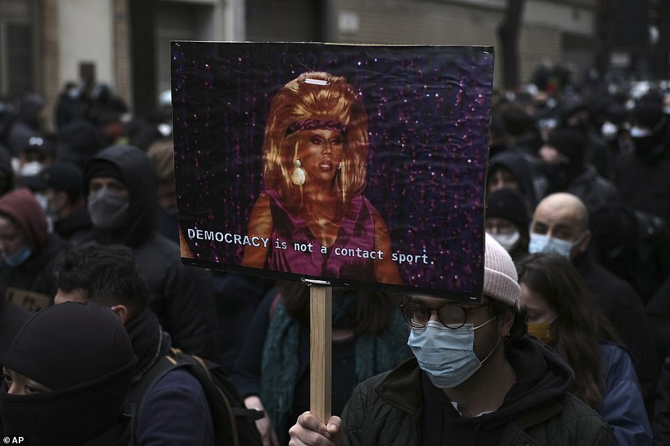 Thousands of people marched in Paris, holding placards and banners against the General Security bill