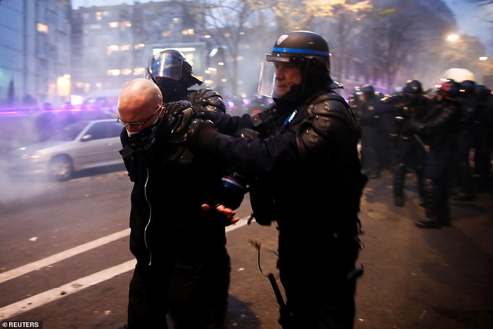 Violent clashes continued into the afternoon as police were forced to detain members of the protest in Paris