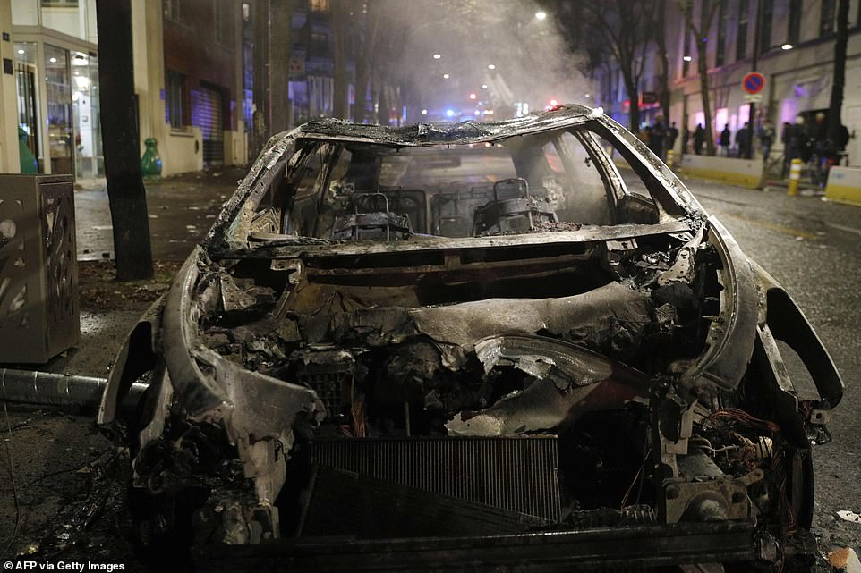 Cars were seen burnt out this evening after protests resulted in cars being set alight across the capital