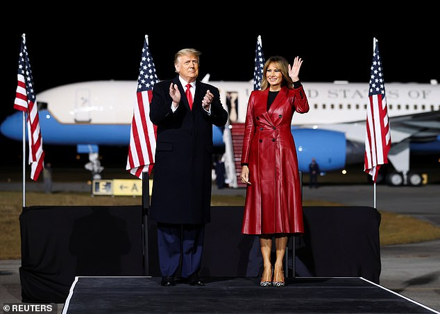 The First Lady cut a stylish figure in the double-breasted belted coat from the British brand, teaming the high-fashion piece with a pair of Manolo Blahnik heels