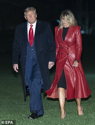 The First Lady's vibrant red coat perfectly matched her husband's choice of scarlet tie for the occasion