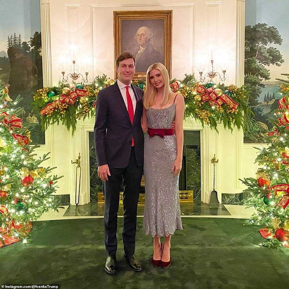 Teaming her silver and crimson bow dress with red heels wore her hair down for the event. Husband Jared complimented her outfit a suit and matching red tie. The pair pose with their arms around each other in one image posted by Ivanka