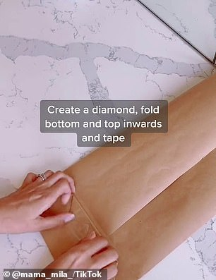 'Fold your wrapping paper into a trifold and tape it,' Chantel posted (pictured), alongside a clip showing how