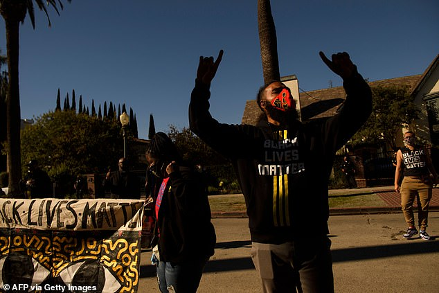 Since the violence yesterday, several political figures have spoken out to denounce the actions of the LAPD. Pictured: Protest outside the mayor's residence on November 30