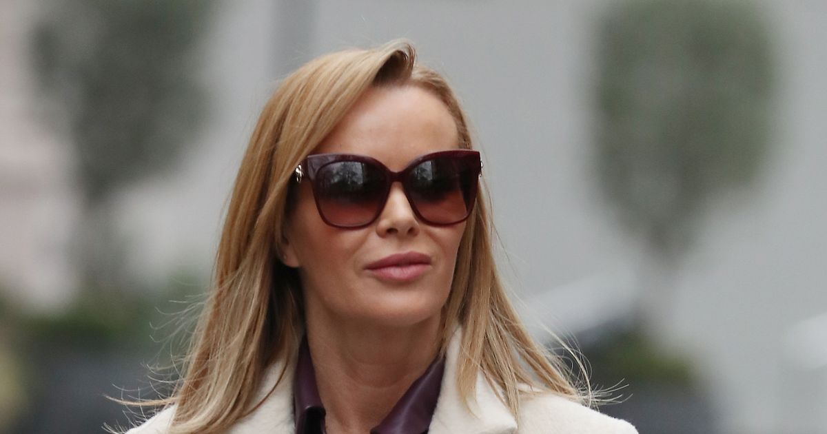 Amanda Holden looks effortlessly chic in leather dress and sexy thigh-high boots