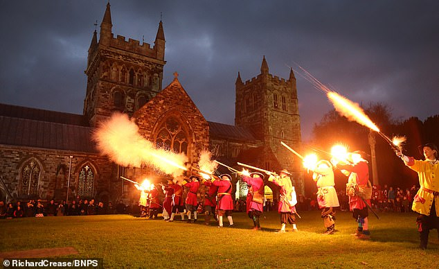 Wimborne Militia entertain the crowd by firing their muskets. The group relies on social media to keep the public informed of its activities - especially during the coronavirus pandemic