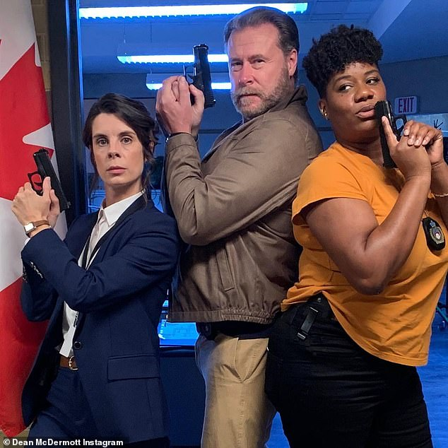 'I'm just bummed I wasn't there': The 47-year-old heiress' husband Dean McDermott wasn't included because he's still filming CBC detective drama Lady Dicks alongside Meredith MacNeill (L) and Adrienne C. Moore (R) in his Toronto hometown (pictured September 15)