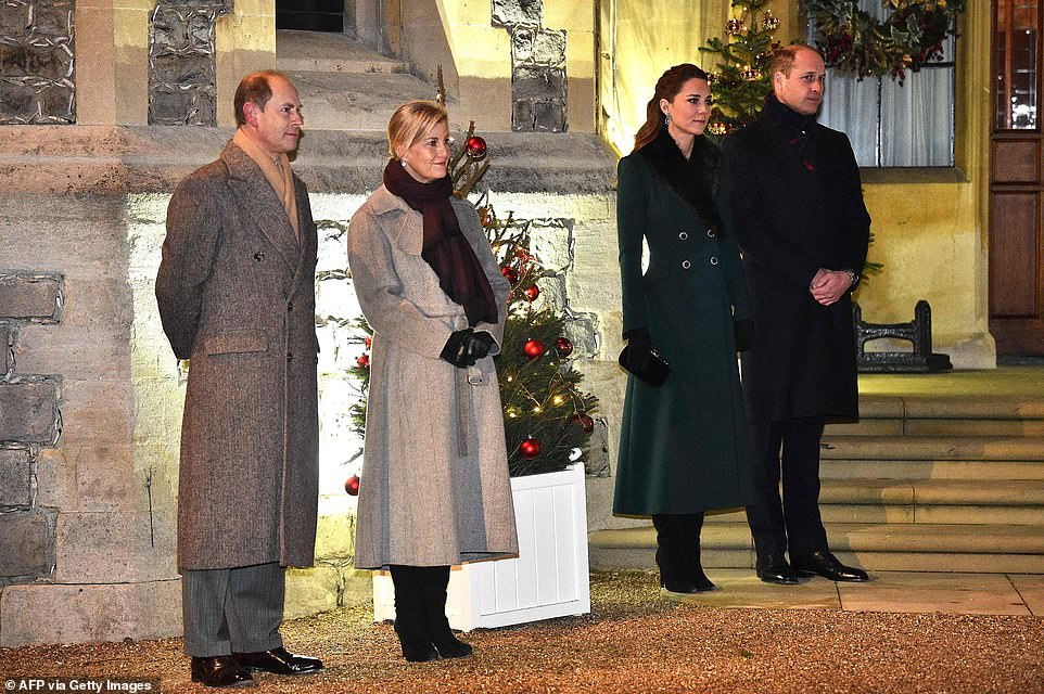 Prince Edward, Earl of Wessex, Britain's Sophie, Countess of Wessex (left), and Catherine, Duchess of Cambridge and Prince William, Duke of Cambridge (right), wait as the Queen thanks local volunteers and key workers for the work they are doing during the coronavirus pandemic and over Christmas in the quadrangle of Windsor Castle