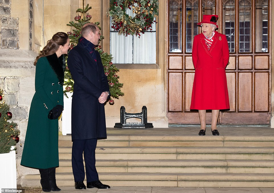Catherine, Duchess of Cambridge, Prince William, Duke of Cambridge and Queen Elizabeth II wait to thank local volunteers and key workers for the work they are doing during the coronavirus pandemic and over Christmas in the quadrangle of Windsor Castle