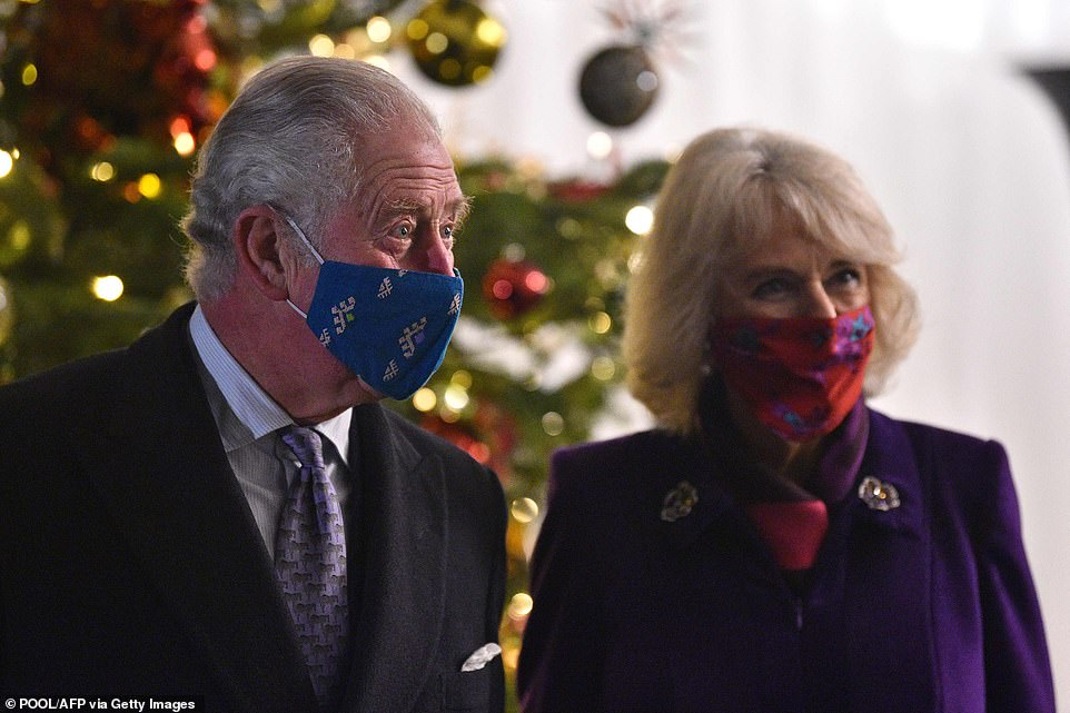 Prince Charles, Prince of Wales (L) and Camilla, Duchess of Cornwall wear colourful face masks while attending the event to thank key workers tonight