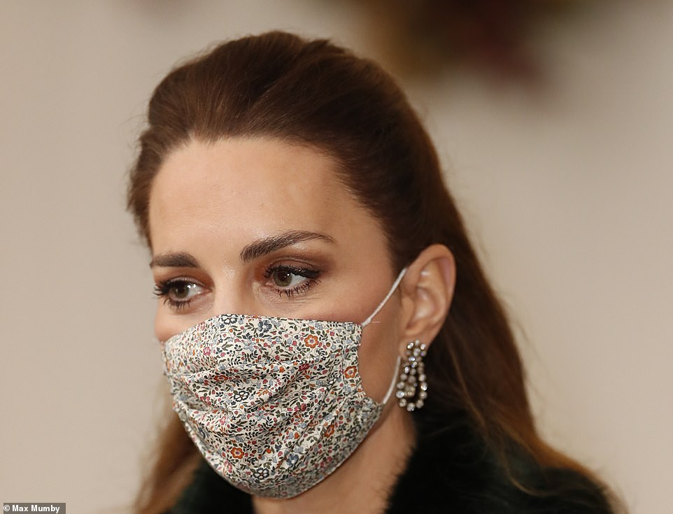 Kate wears a colourful face mask in Windsor this afternoon as she appears with other senior royals at the castle