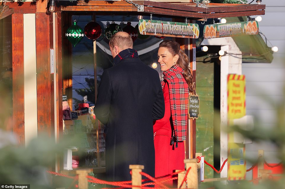 The Duke and Duchess of Cambridge attend a 'Toast Your Own Marshmallow' stall during a visit to Cardiff Castle this morning