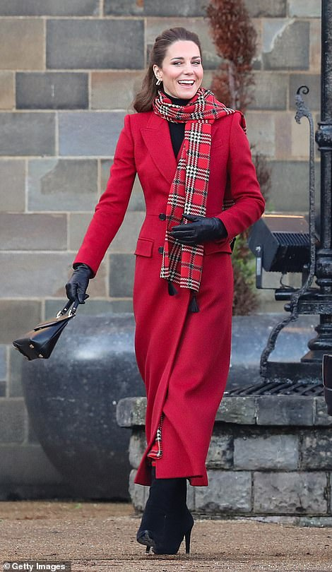 The Duchess of Cambridge is dressed in a long, bright red Alexander McQueen coat as she arrives at Cardiff Castle today