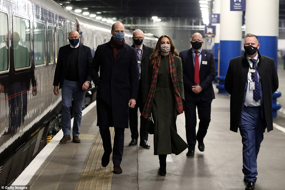 William and Kate board the royal train at London Euston railway station yesterday as the embark on the three-day tour