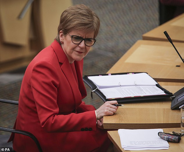 Scottish First Minister Nicola Sturgeon pictured during a ministerial statement in the Scottish Parliament, Edinburgh, on the first day of the largest immunisation programme in UK history
