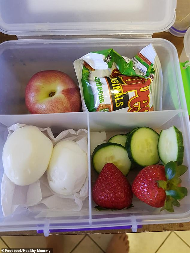 Amelia's child chose two hard-boiled eggs, two strawberries, cucumber, a nectarine and a packet of Shapes on this particular day (pictured)