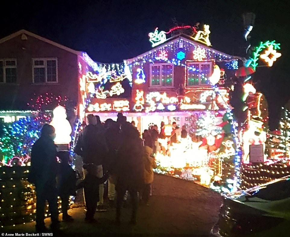 Pictures show families gathering outside the lit-up house and police visiting following a number of complaints from people in the area