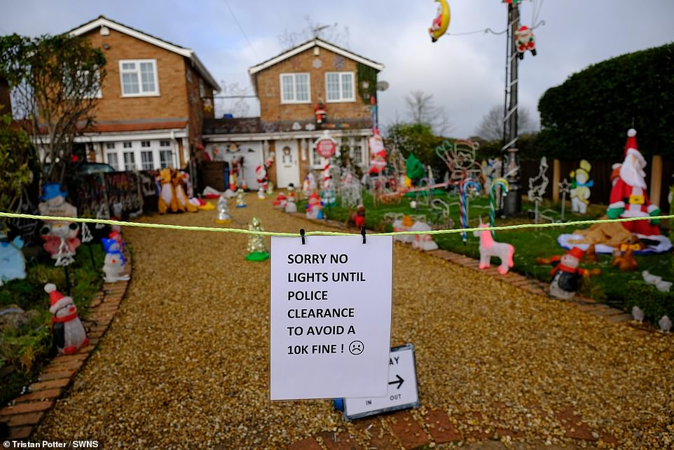 An online fundraiser, set up by Joe Taylor, to save the display (pictured) has already raised £300. Mr Payne has put a sign up outside his home saying he cannot have the lights this year