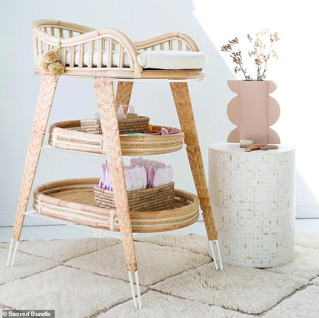 Pricey:Next to the crib is a glimpse of a $640 Sacred Bundle changing table