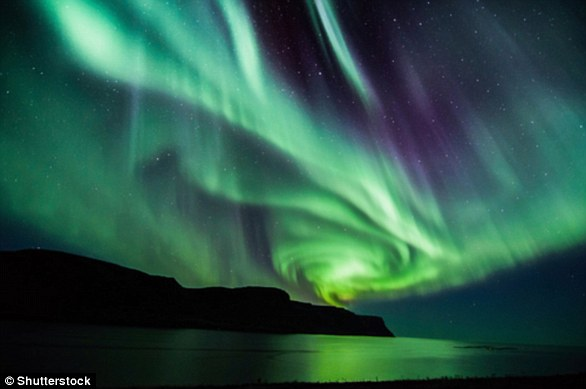 There are two types of Aurora - Aurora Borealis (file photo), which means 'dawn of the north', and Aurora Australis, 'dawn of the south.' The displays light up when electrically charged particles from the sun enter the Earth's atmosphere