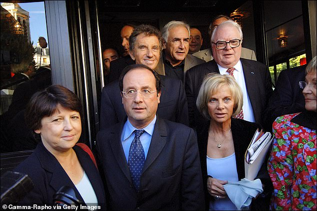 Lang, (pictured left in the back) with DSK (center, back) , Guigou (right), and former French president Francois Hollande (centre) in 2005. With Strauss-Kahn abandoning the race for the French presidency due to the sexual assault allegations against him in New York, Hollande became the candidate for the Socialist Party at the 2012 and went on to win against incumbent president Nicolas Sarkozy