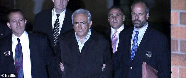 Dominique Strauss-Kahn being escorted by police during his 'perp walk' in May 2011 following the rape accusations made by Nafissatou Diallo