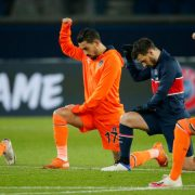 PSG and Istanbul Basaksehir players in anti-racism gesture before game resumes