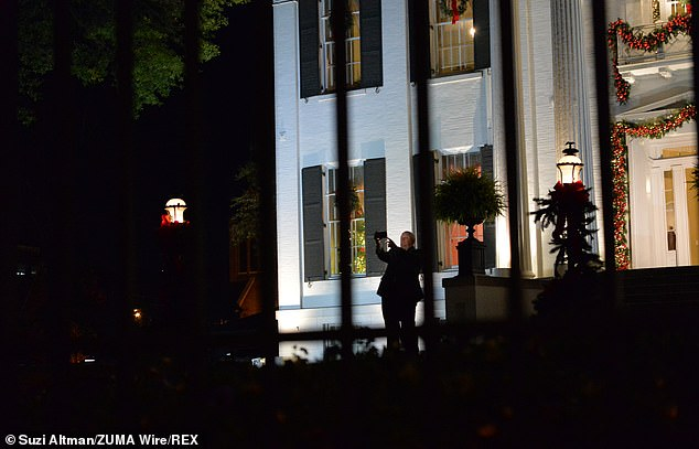 The Republican governor mingled with guests in the grounds of the Governor's Mansion Wednesday night