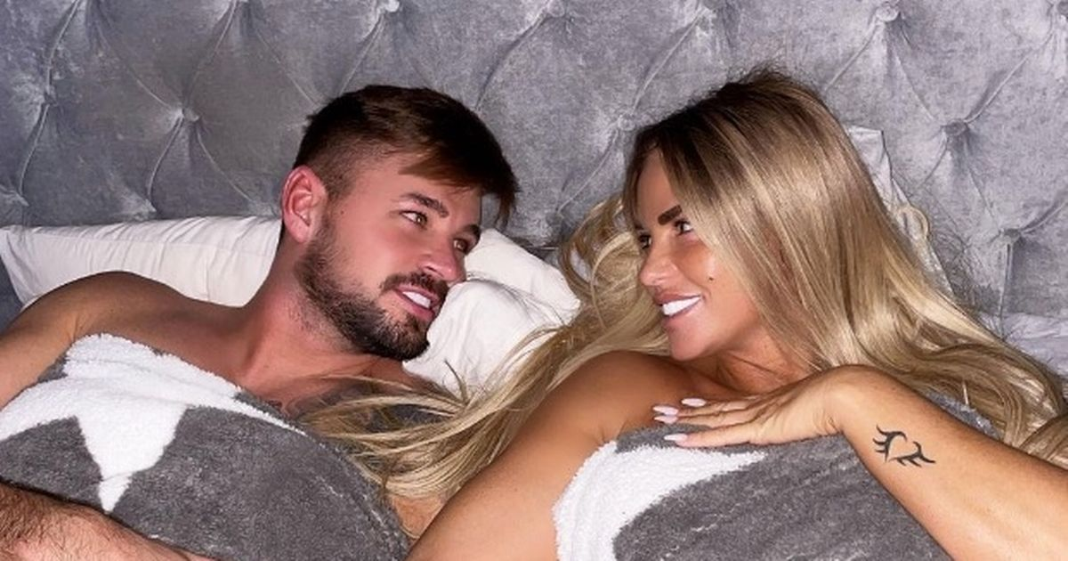 Katie Price strips topless for intimate bed snap as she swoons over Carl Woods