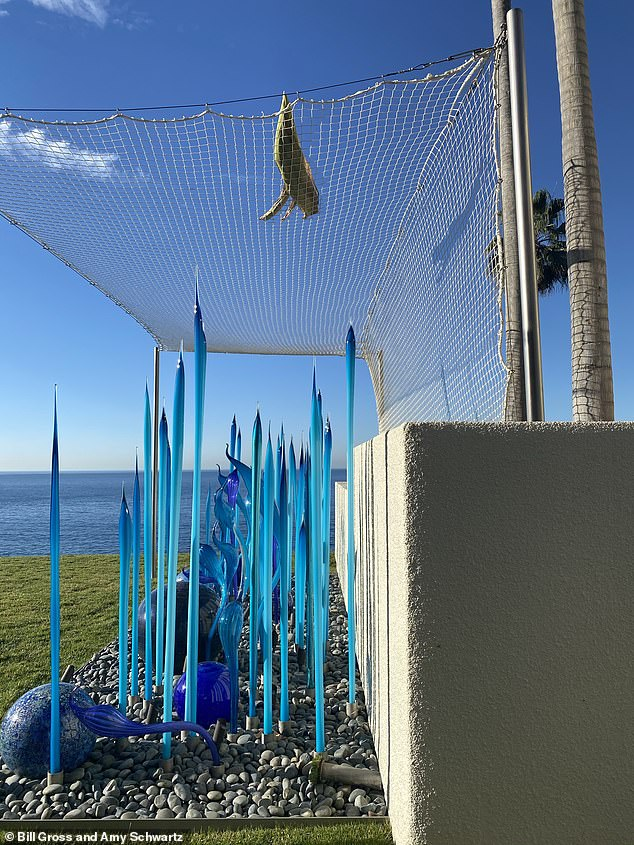 Gross installed the net to protect the fragile blown-glass sculpture from falling palm fronds