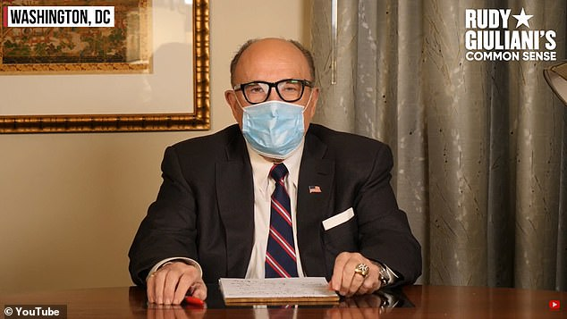 Giuliani wore a mask for part of the video but still claimed that are excessive at times