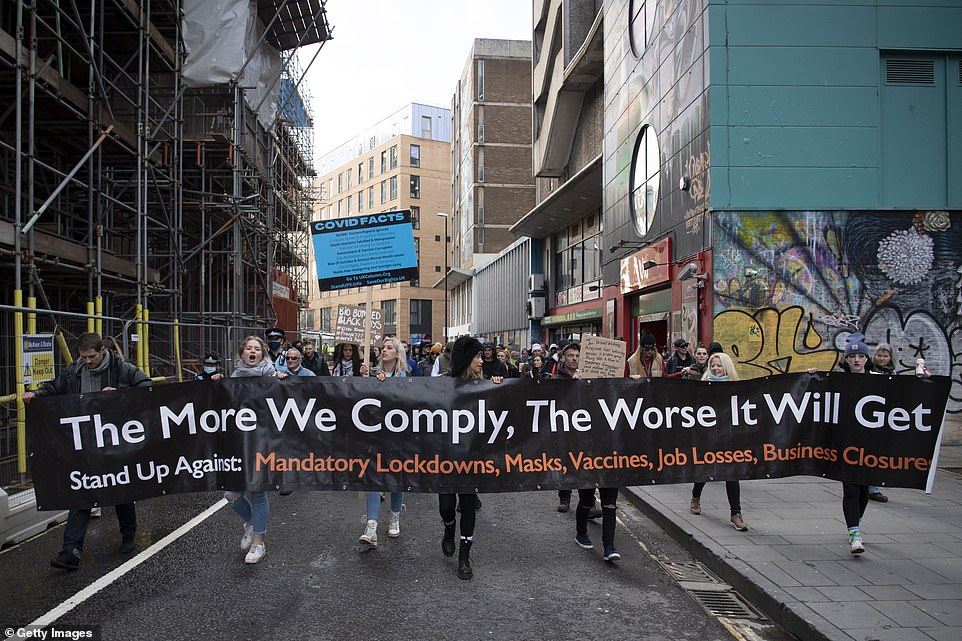 Protestors in Bristol marched through the city centre with a sign reading 'the more we comply, the worst it will get' as they asked others to stand up against 'mandatory lockdowns, masks, vaccines, job losses and business closure'. Anti-lockdown protestors do not believe in the pandemic