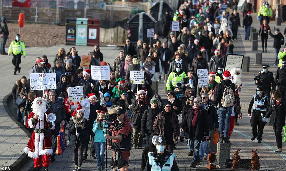 Supporters of campaign group Save Our Rights UK gathered at the Peace Statue by Hove Lawns in Brighton at 12pm this afternoon. A crowd of hundreds made its way west along the seafront before heading down Queen's Road.A man in a Father Christmas outfit used a megaphone to speak to the crowd