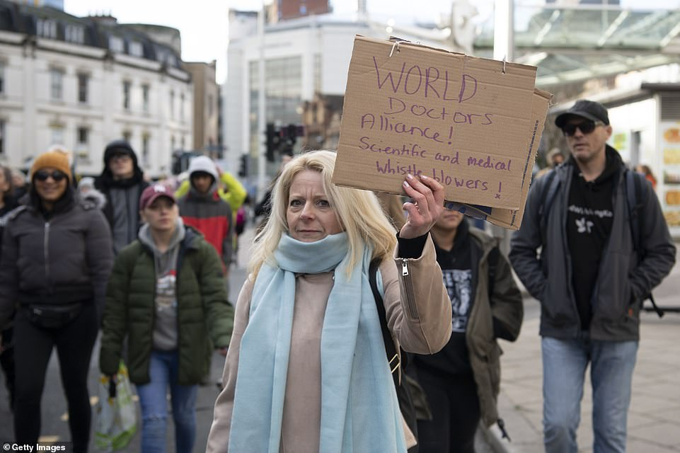 A woman held a sign that read 'World doctors alliance. Scientific and medical whistle blowers' as she joined the protest in Bristol earlier Saturday afternoon
