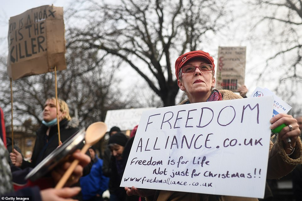 A woman in Edinburgh smiled as she held a sign saying 'freedom is for life not just for Christmas', in reference to the relaxation of rules over the Christmas period to allow families to meet up