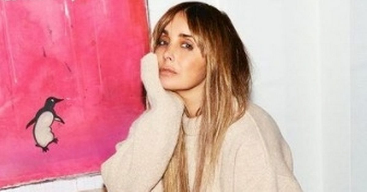 Louise Redknapp glams up for snap after her cryptic post with a love poem