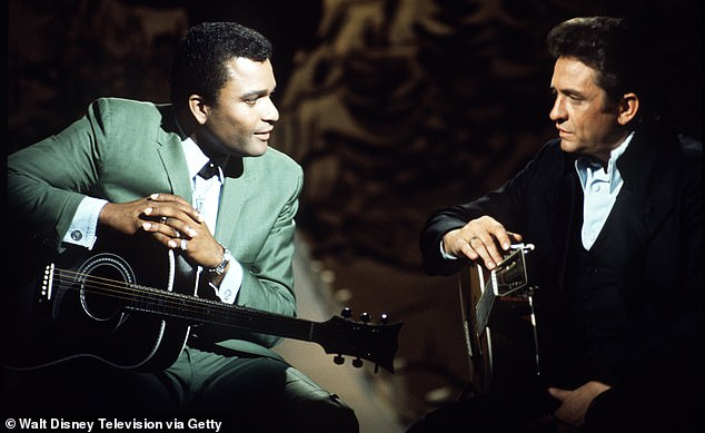 Pride is pictured with Johnny Cash on The Johnny Cash Show in May 1970