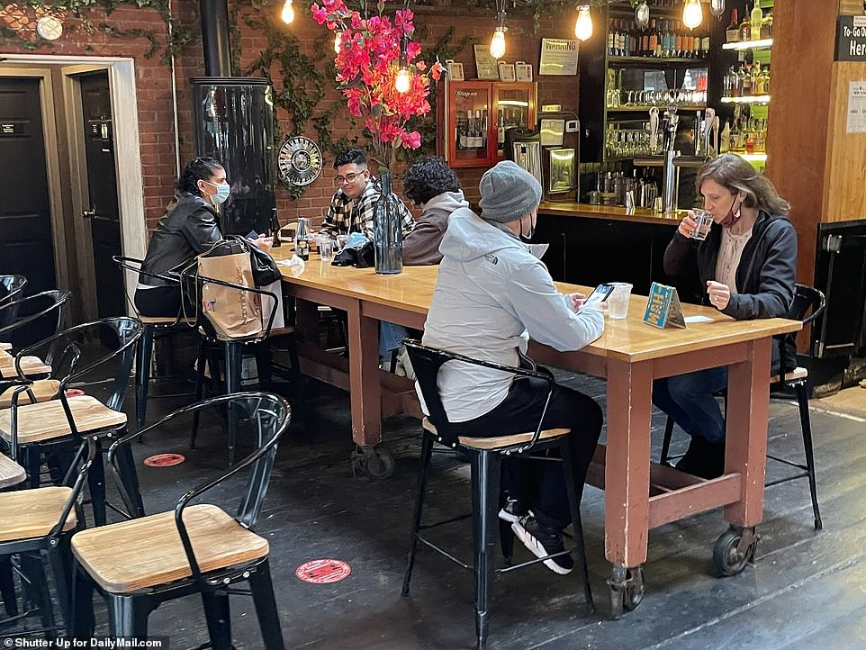 During the daytime, people were spotted brunching and having a festive drink inside several restaurants in Soho, Manhattan. Pictured Soho Park