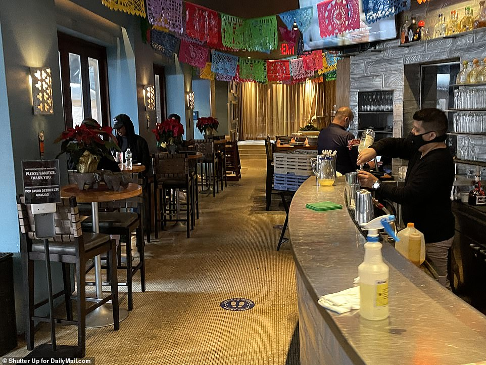 Diners inside Dos Caminos in Soho Saturday daytime.The move to shutter indoor dining marks a major blow to the city's hard-hit restaurants which had only ever been able to reopen at a 25 percent capacity indoors since they first closed back in March