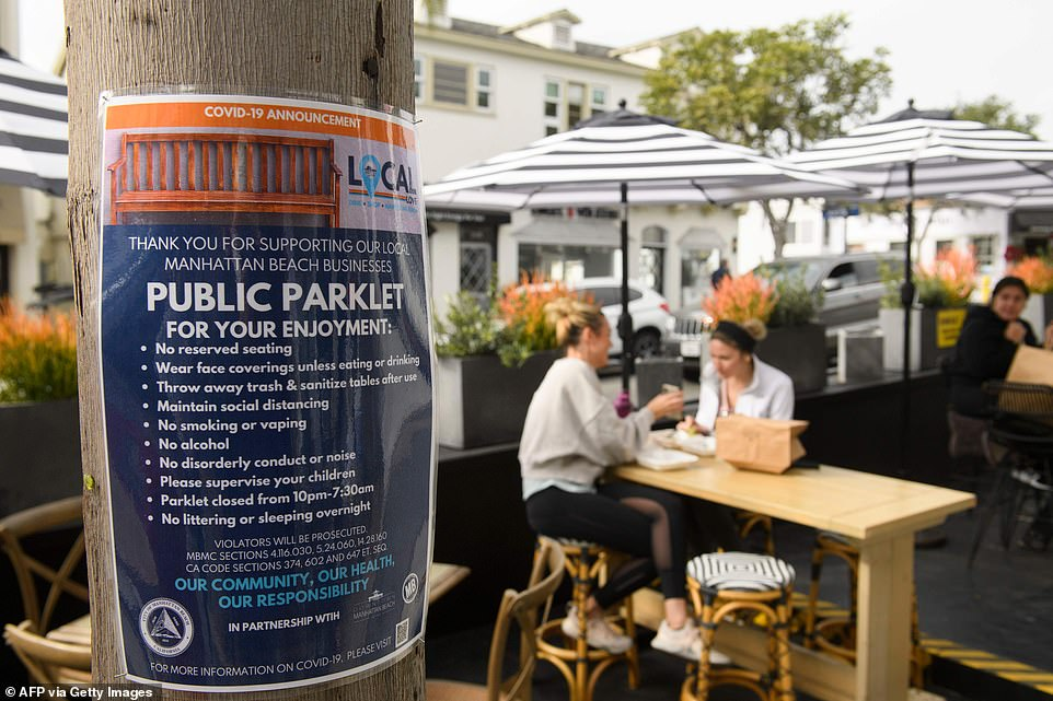 A 'Public Parklet' sign shows the public dining spot's rules including that it is closed from 10 p.m. to 7:30 a.m.