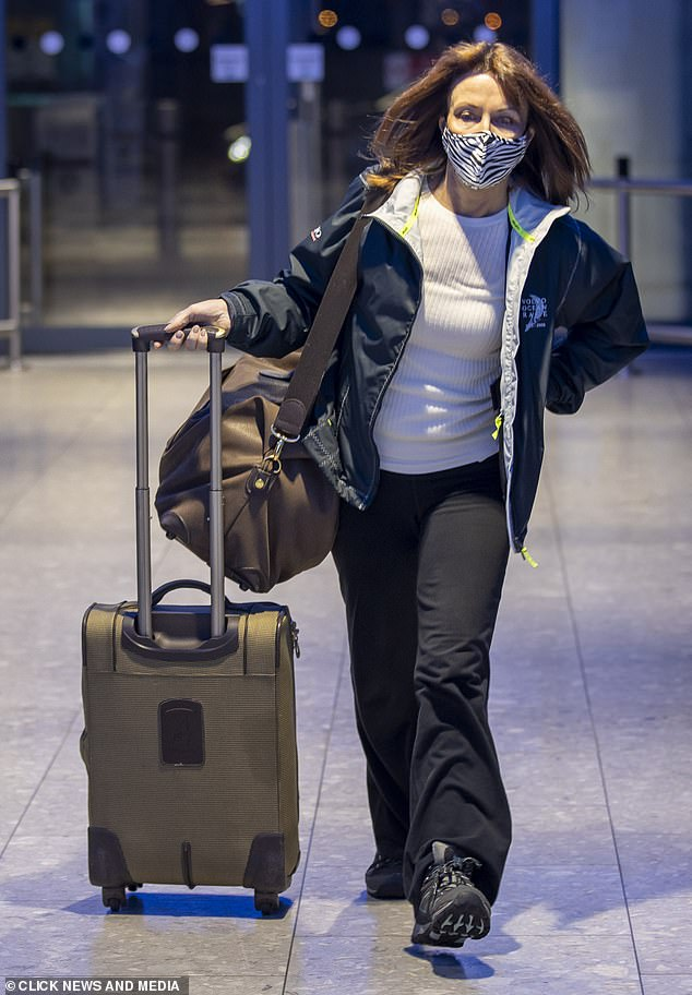 ESCAPE: Kay Burley's 60th birthday rule breach was leaked to the media in an email sting by her own Sky TV colleagues. Pictured: Burley in Heathrow Airport, en route to an African safari, on Friday as the shamed £600,000-a-year presenter is pictured flying off into exile