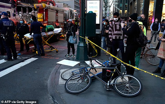 Bikes lie on the ground after a car struck multiple protesters in Manhattan gathered in support of people on hunger strike in an ICE detention center
