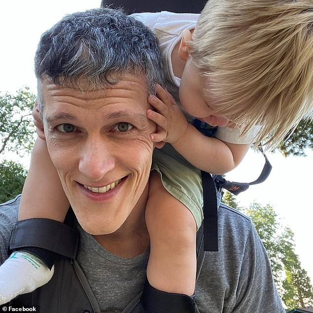 Ian Jenkins, pictured with son Parker, has written a book called Three Dads and a Baby, that is released next March, on their unusual family