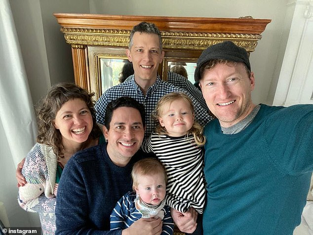 The dads (left to right), Alan, Ian and Jeremy, are pictured here with their children Parker and Piper, and their biological mother Meghan who donated eggs which were then carried by two different surrogates