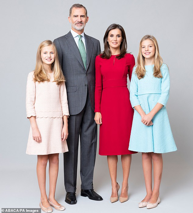Growing up: Teenagers Princess Leonor and Infanta Sofía last appeared on the family's annual Christmas card without their parents in 2015 (Pictured from left in February: Princess Leonor, King Felipe VI and Queen Letizia, Infanta Sofia)