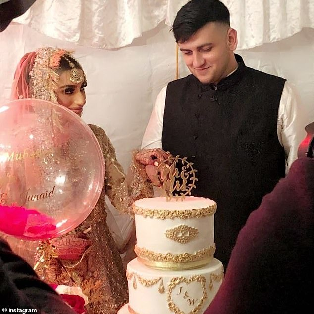 Reception:The newlywed couple held hands as they cut into the elaborate cake in front of their reception of guests, while Waliyha gazed adoringly at her other half