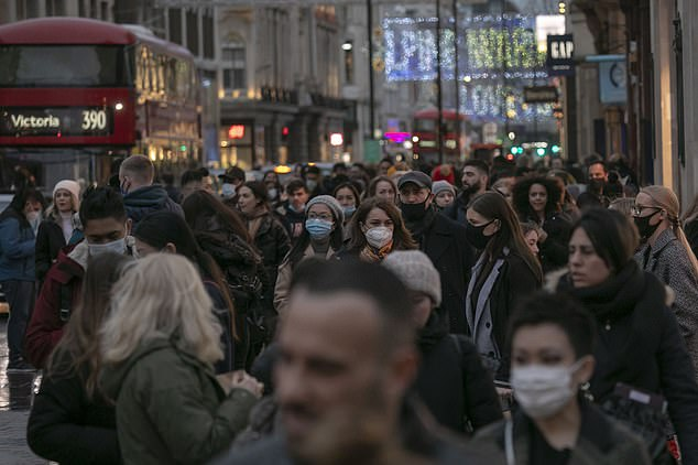 Most shoppers on a busy Oxford Street wore masks but there were some who went without as they wandered between the shops in London