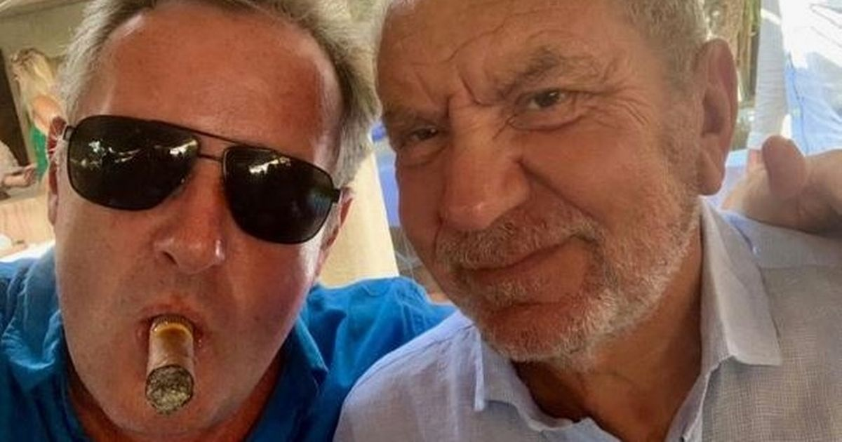 Lord Sugar escalates feud with Piers Morgan as he takes aim over mask-free snap