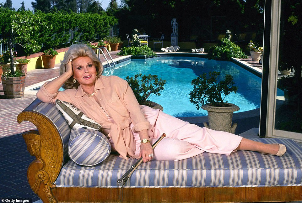 Gabor bought the property in 1973 and lived there until she died at 99 in 2016. Gabor is pictured lounging by the pool in 1990