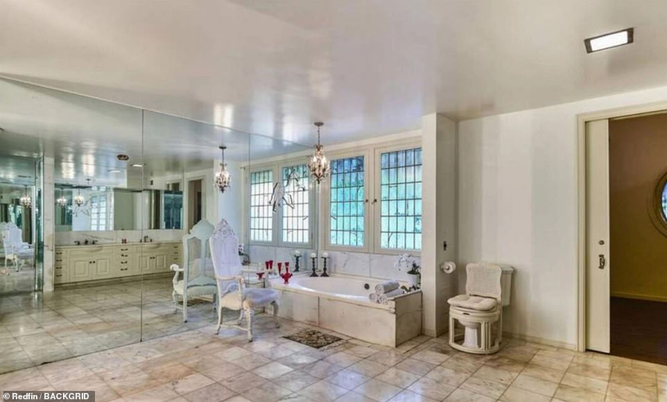 One of the opulently-decorated bathrooms in Gabor's home while she lived there. The toilet appears to be disguised as a chair